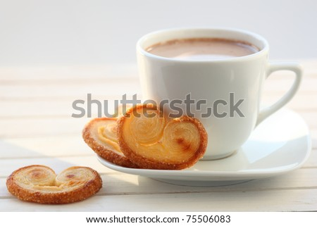 Breakfast with cup of cocoa and biscuits