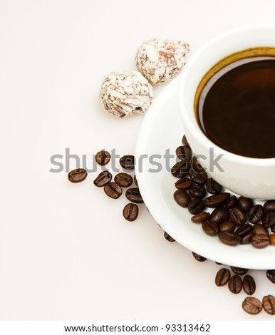 Breakfast with cup of coffee and truffles - stock photo