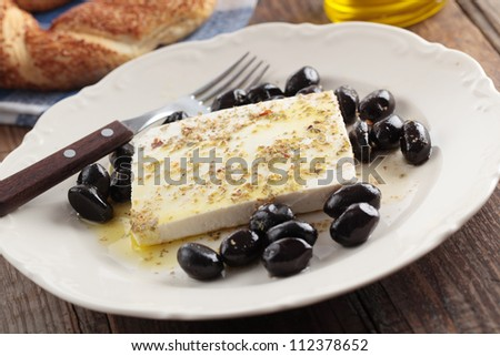 Breakfast with feta cheese, olives, simit, olive oil and spices