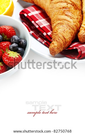 Breakfast with Fresh Croissants and berries over white