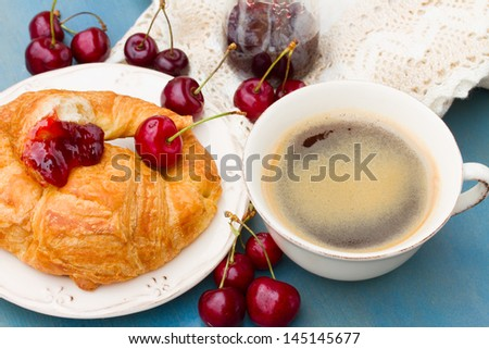 breakfast with  fresh croissants and  chery berries