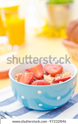 Breakfast with fresh muesli and orange juice