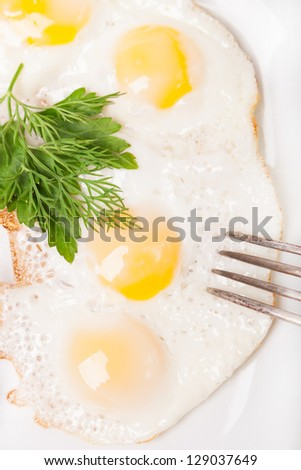 breakfast with fried eggs on white plate