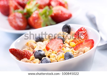 Breakfast with granola cereals and fresh berries