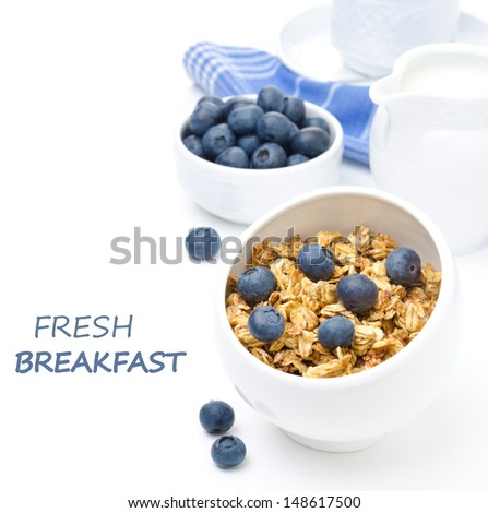 breakfast with homemade granola, blueberries and black coffee closeup isolated on a white background