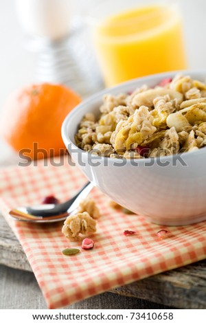 Breakfast with muesli, boiled egg and orange juice