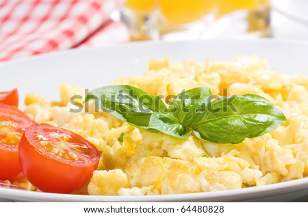 breakfast with scrambled egg and vegetables