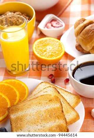 breakfast with toasts jam and fruits