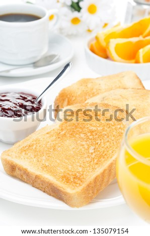 breakfast with toasts, jam, coffee and orange juice vertical