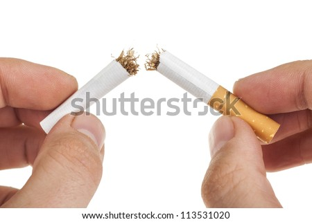 breaking a cigarette. Isolated on a white background