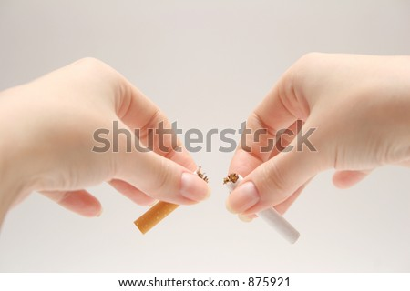 Breaking a cigarette. NO SMOKING !