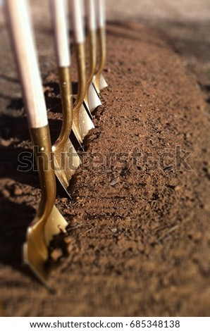 Breaking Ground and New Beginnings - Shovels in Dirt #685348138