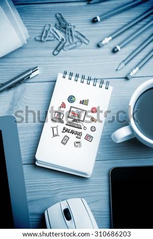 breaking news doodle against notepad on desk