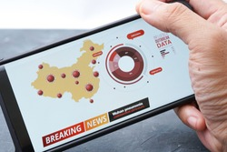 Breaking news on mobile phone highlighting total virus infected with coronavirus outbreak in China. Coronavirus or wuhan pneumonia, 2019-nCoV are new Chinese Coronavirus Outbreak.
