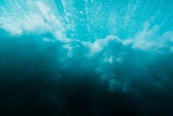 Breaking ocean wave is underwater. Ocean texture in underwater