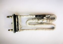 Breaking petn of the washing machine. Heater or tubular electric and scum requires replacing the heating element. Close-up photo on a white background