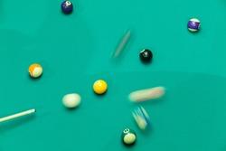 Breaking Pool Balls on green table