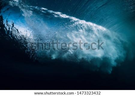 Breaking wave in underwater. Ocean in underwater