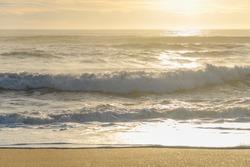 Breaking waves on an Atlantic Ocean beach.