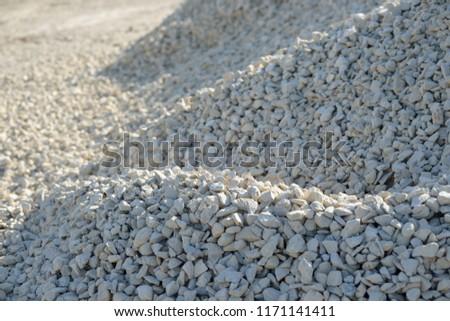 Breakstone background. Road gravel.