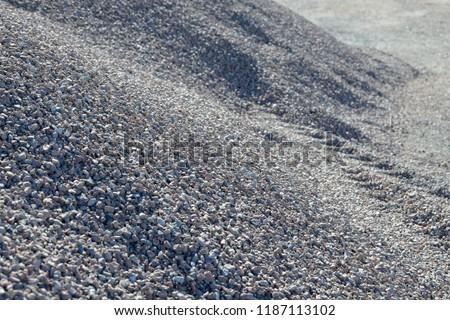 Breakstone background. Road gravel. Gravel texture. Crushed Gravel background. Piles of limestone rocks. Break stones on construction site.