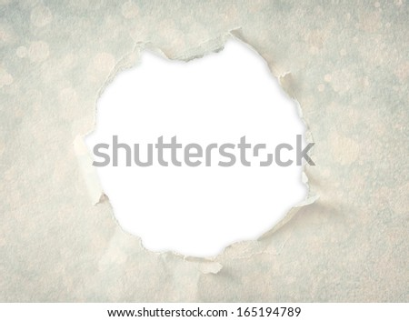 Breakthrough paper hole made from textured paper and circles pattern.