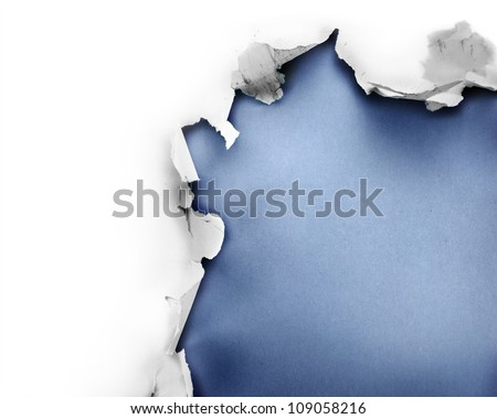 Breakthrough paper hole with blue background, isolated on white.