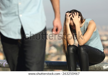 Breakup of a couple with bad guy and sad girlfriend with a city in the background