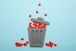 Breakup of red hearts. Love in trash can. Divorce and separation.