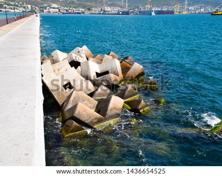 Breakwater blocks in the port. Breakwater of the rectangular stone figures. #1436654525