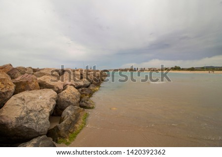 breakwater, breakwater on the coast of Vilanova i la Geltru, Barcelona, Catalonia, Spain. The Garraf. Long Beach. Holidays. Summer. #1420392362