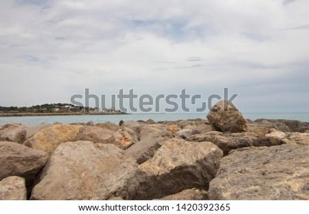 breakwater, breakwater on the coast of Vilanova i la Geltru, Barcelona, Catalonia, Spain. The Garraf. Long Beach. Holidays. Summer. #1420392365