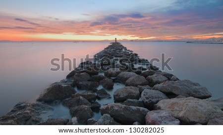 Breakwater rocks on the Gulf of Roses, Spain, at long exposure.