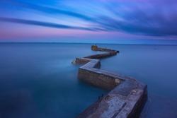 Breakwater zig zag pier at St Monans, Fife, scotland, uk.