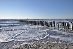 Breakwaters on a winter beach in Vlissingen Holland