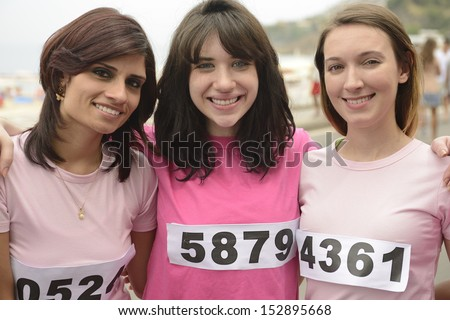 Breast cancer awareness charity race: Three women in pink