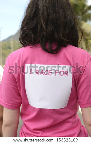 Breast cancer awareness event: woman with sticker