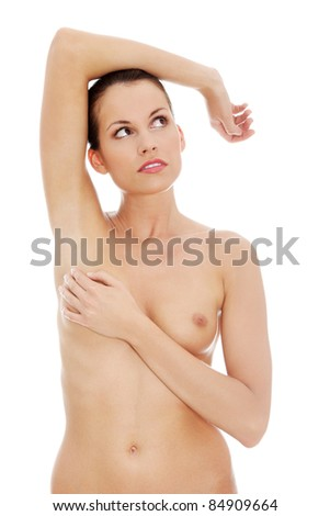 Breast cancer concept, woman holding her breast, isolated on white background - stock photo
