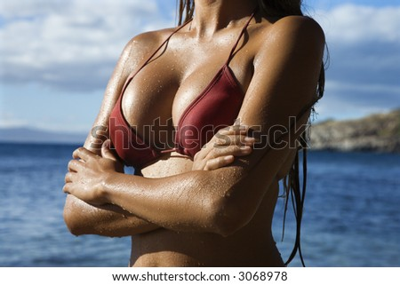 stock photo : Breast shot of young adult Asian Filipino in bikini on beach ...