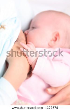 Breastfeeding - focus on tiny hand