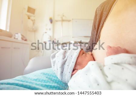 Breastfeeding little infant boy in ICU hospital