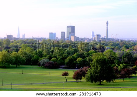 Breath-taking panoramic scenic view of London cityscape seen from beautiful Primrose Hill in St. Regents park on a sunny summer morning