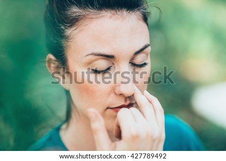 Breathing exercise Pranayama - Alternate nostril breathing, often performed for stress and anxiety relief #427789492
