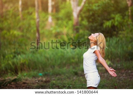 breathing exercises, woman enjoying the nature outdoors in the forest