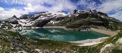 Breathtaking alpine hike to the turquoise glacial lake. Beautiful mountain scenery all around us.