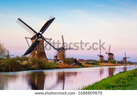 breathtaking beautiful inspirational landscape with windmills in Kinderdijk, Netherlands at sunset. Fascinating places, tourist attraction. Stock photo ©