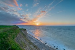 Breathtaking beautiful panorama view of wild romantic coastal cliff landscape at the Baltic Sea at the Wangels, Ostholstein, Schleswig-Holstein, Germany, cliff coast line by Hohwacht Bay by sunset