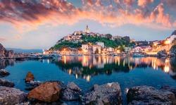 Breathtaking evening cityscape of Vrbnik town. Dramatic summer seascape of Adriatic sea, Krk island, Kvarner bay archipelago, Croatia, Europe. Beautiful world of Mediterranean countries.