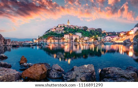 Breathtaking evening cityscape of Vrbnik town. Dramatic summer seascape of Adriatic sea, Krk island, Kvarner bay archipelago, Croatia, Europe. Beautiful world of Mediterranean countries.