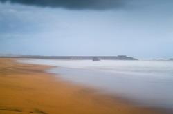 Breathtaking landscape scenery in the paradise island of Sri Lanka, long exposure sandy beach photograph.